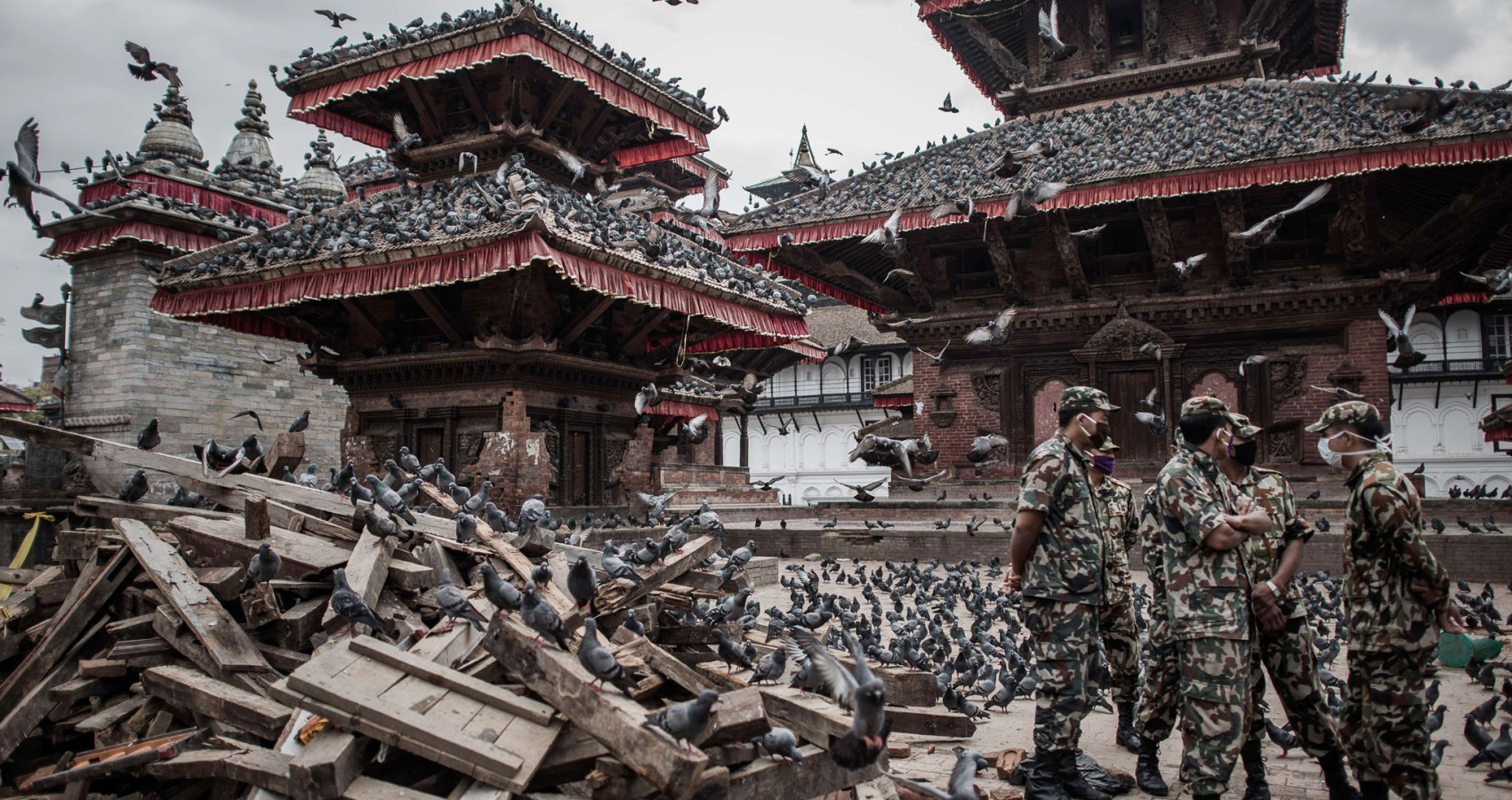 TOPSHOTS Nepalese soldiers stand next to wrecked buildings at Durbar square, a UNESCO world heritage site that was badly damaged by the earthquake, in the historical centre of Kathmandu on April 29, 2015,  following a 7.8 magnitude earthquake which struck the Himalayan nation on April 25. Rescuers are facing a race against time  to find survivors of a mammoth earthquake that killed more than 5,000 people when it through Nepal five days ago and devastated large parts of one of Asia's poorest nations.    AFP PHOTO / Philippe LopezPHILIPPE LOPEZ/AFP/Getty Images