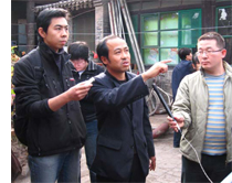 Mr. Zhao (center) explaining the characteristics of a traditional courtyard house to Chinese trainees.
