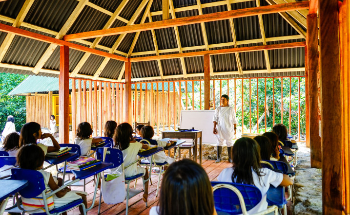CIUDAD PERDIDA, COLOMBIA – The school's headmaster and indigenous Kogi students in the middle of a lesson. ©Santiago Giraldo/Global Heritage Fund