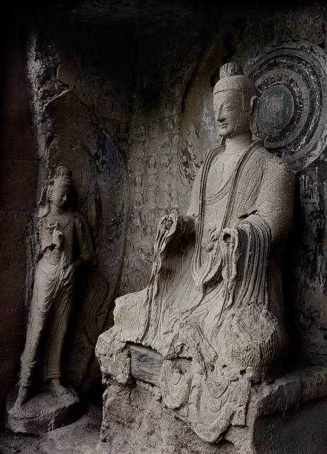 A buddha and bodhisattva preside in one of the grottoes at Maijishan. ©Maijishan Grotto Art Institute and Global Heritage Fund